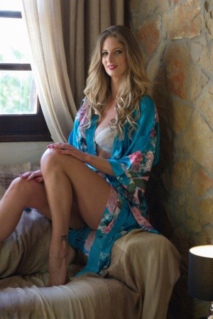 Glamour model Rebecca Leah slips off her robe and brassiere to go topless