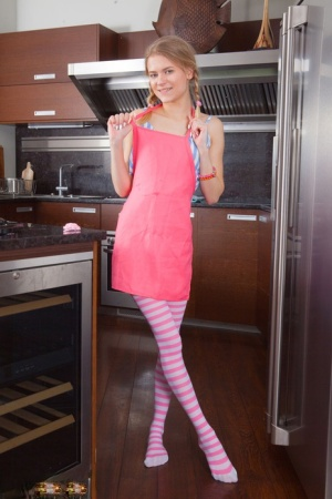 Adorable teen Lili bakes a cake in thigh highs before parting her pussy lips