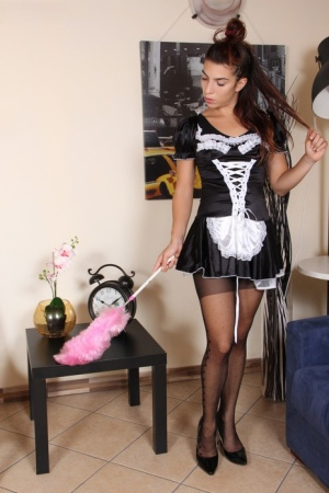 Clothed maid Tecla takes off her red soled heels while wearing polka dot hose