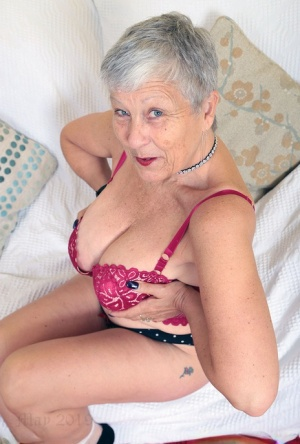 Hot oma Savana uncorks her great tits before pulling down her underwear 82663488