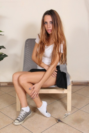 Hot redhead Elettra frees her beautiful feet from socks and canvas sneakers