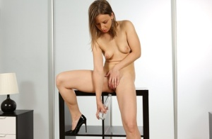 Kinky woman Lilith Sweet drinks her own piss during a masturbation session