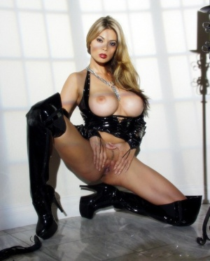 Hot Asian chick Tera Patrick plays with her vagina in thigh high latex boots