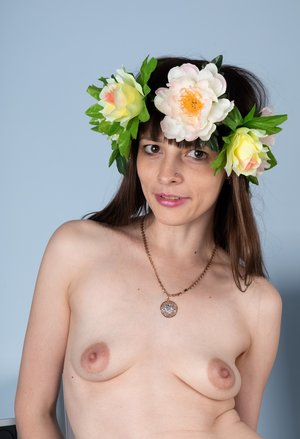 First timer Adriana Vittoria wears a crown of flowers while baring her beaver