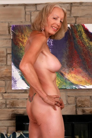 Hot oma Super Sexy plays with her pussy after stripping to ankle strap shoes