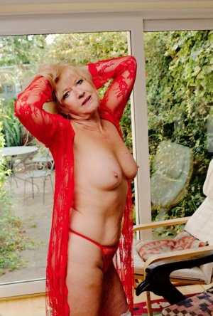 Blonde granny slips off see thru lingerie to play the violin in the nude