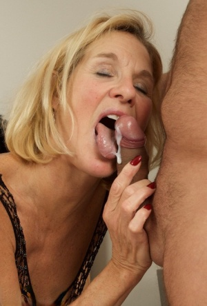 Blonde amateur sucks the cum from a cock after fucking in OTK boots