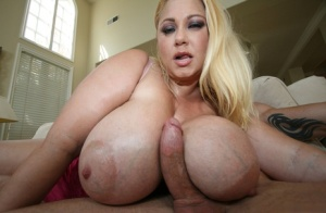 Blonde chick with giant breasts licks jizz off them after a hardcore fuck