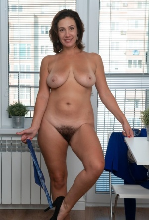 Amateur woman Gadget uncovers her big naturals before spreading her hairy bush