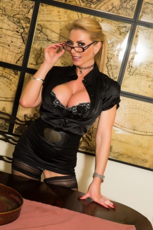 Hot blonde businesswoman Lynda Leigh sets her big tits free in sexy stockings