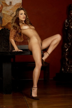 Solo girl Andie Valentino highlights her legs while posing nude for Penthouse 92091676