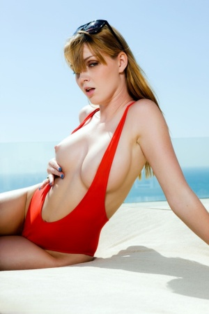 Redhead model Maria McCray doffs a swimsuit to pose nude for Penthouse