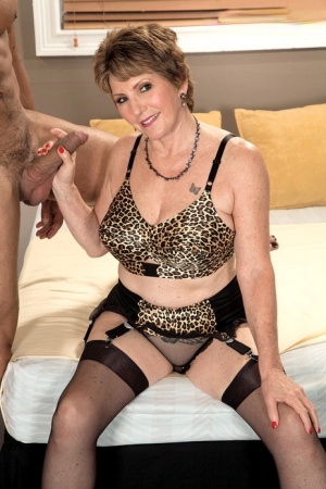 Horny granny Bea Cummins gets on top of younger stud in garters and nylons