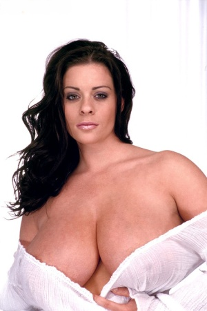 Big titted female Linsey Dawn McKenzie holds her juggs after disrobing 67551809
