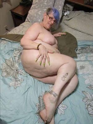 Overweight nan Bunny Gram sports dyed hair while masturbating on a bed