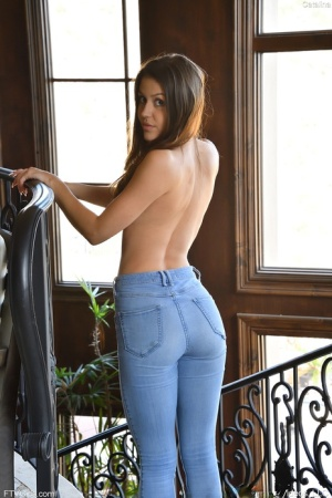 Teen amateur Catalina slips blue jeans over her hot ass before masturbating
