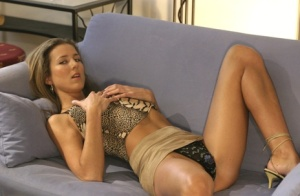 Clothed amateur Susy Rocks shows her great legs while disrobing to underthings