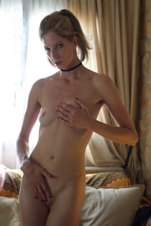Glamour model Rebecca Leah strips naked in her bedroom wearing a black choker 94663299