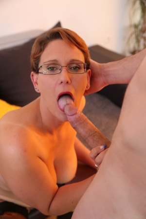 Short haired French woman sucks and fucks a large dick with her glasses on