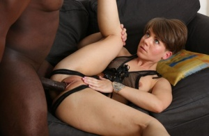Short haired woman sucks on a big black dick after anal fucking on a sofa