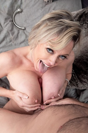 Big titted cougar Dee Williams titty fucks a hard cock during POV action