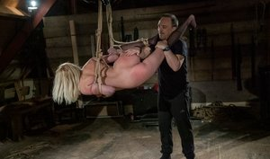 Blonde submissive is masturbated after being restrained by ropes