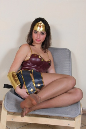 Solo female Ilaria shows the soles of hose clad feet in cosplay outfit