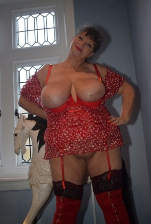 Fat granny shows her huge boobs and big ass in over the knee boots