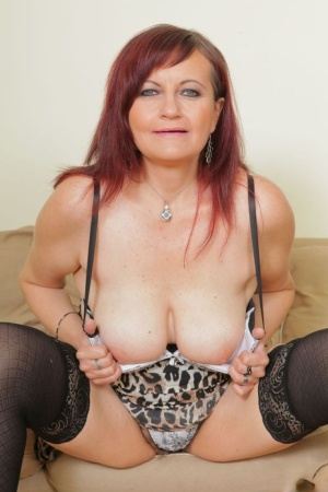Old redhead goes pussy to mouth with a black cock in heels and hosiery