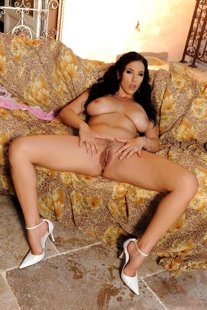 Solo model Jelena Jensen shows off her oil slicked body after lingerie removal
