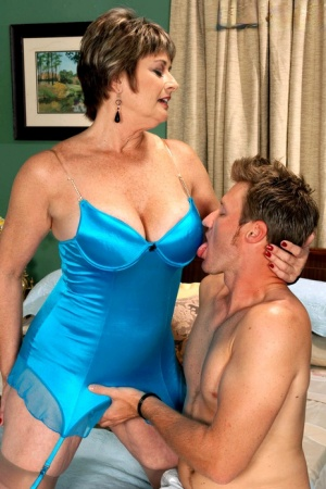 Short haired mature lady seduces her son-in-law in satin lingerie and nylons