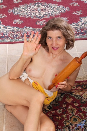 Horny older granny naked in her apron toying with rolling pin in the kitchen