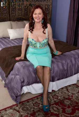 Redheaded granny Katherine Merlot gets on top of her toy boys large dick