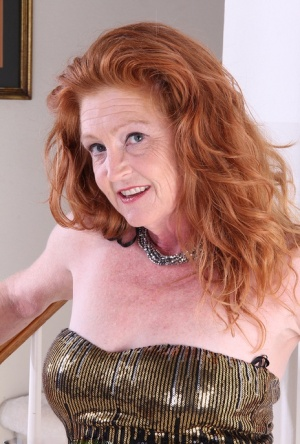 Hot redhead granny Tami Estelle flaunts small saggy tits  smooth bald pussy