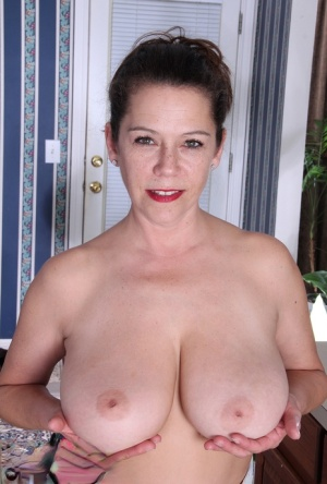 Beautiful mature Christy cooking in the kitchen with her big saggy tits bare