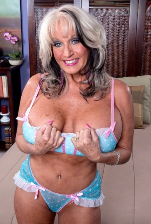 Hot mature woman Sally Dangelo uncups her huge tits for her toy boy