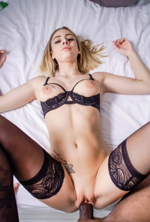 Dirty blonde Lya Missy goes pussy to mouth with a black cock in a cupless bra