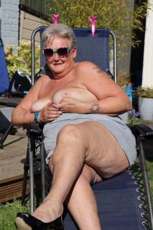 Fat nan Valgasmic Exposed shows her tits and snatch on a backyard lounge chair