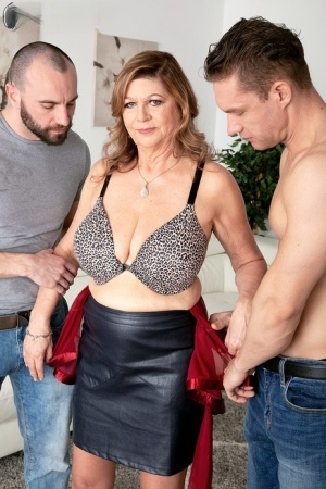 Big titted granny Brenda Douglas takes on two younger men and their big cocks