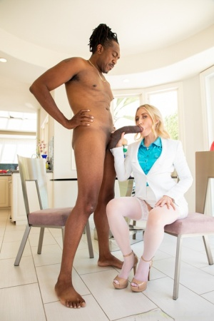 Blonde chick Riley Reyes takes a massive black penis in her mouth