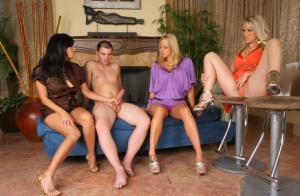 Clothed babes invite a young boy inside and teach him the ways of sex