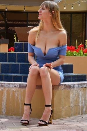Long legged amateur Angel toys her twat in ankle strap heels by a patio gate