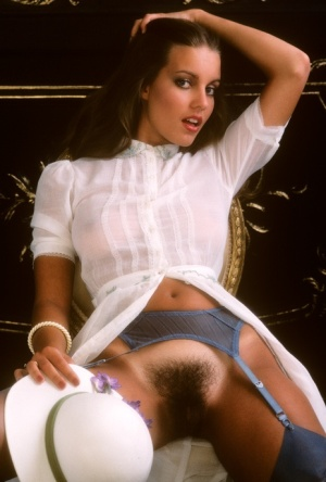 Pretty girl Lisa Welch shows hairy bush wearing vintage stockings outdoors