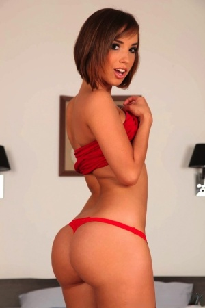 Short haired amateur in short red dress shows off her flexibility during sex