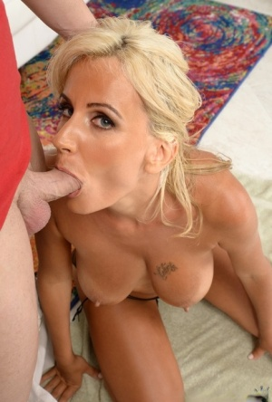 Older lady with big natural tits and a bald twat gets fucked on a white sofa 62524207