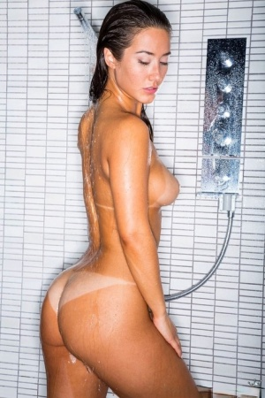 Sexy lesbian girls with firm big tits licking ass & kissing in the shower