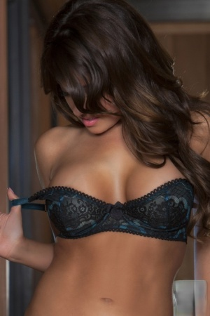 Busty brunette centerfold Victoria Marquez posing in sexy lingerie  stockings