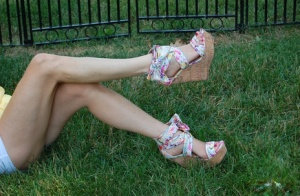 Non nude female Kelly Anderson displays her pretty feet on the lush grass