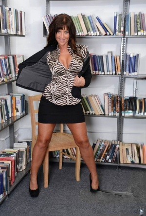 Horny mature librarian helps a reader get what hes looking for in her stacks