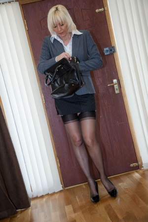 Older MILF Jan Burton strips off business clothes after a hard day at office